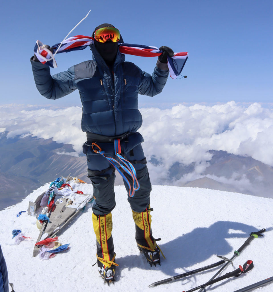 Mark standing on Europes highest peak, Mount Elbrus.