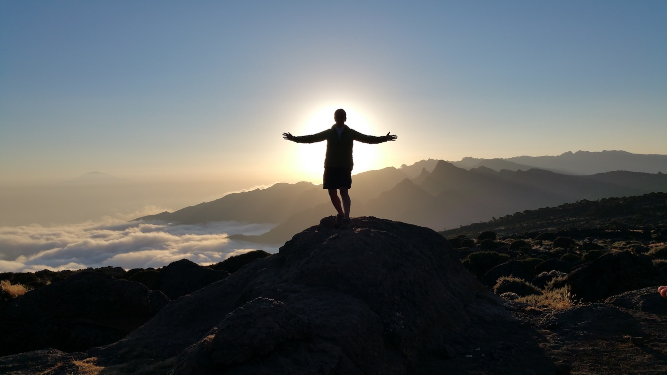 Hiker at sunset on Kilimanjaro, Earth's Edge