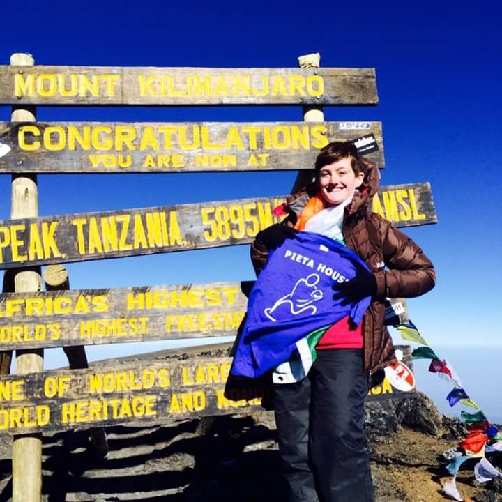 Ellen Ryan at the summit of Kilimanjaro with Earth's Edge
